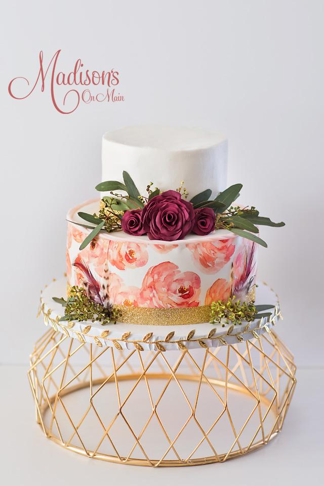 Hand painted white wedding cake with orange flowers