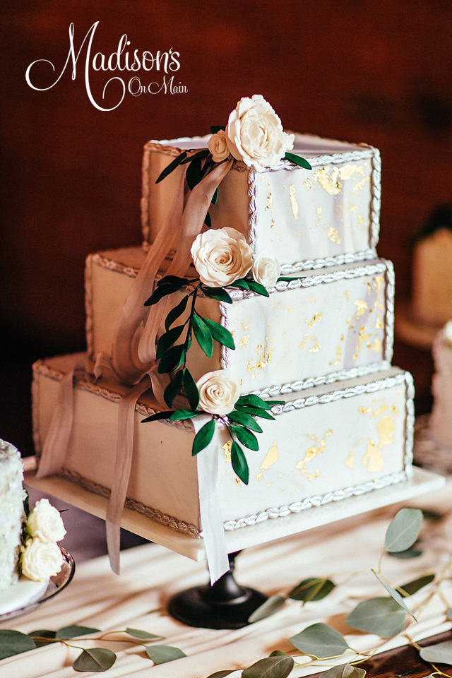 Ivory square tiered wedding cake with gold dust