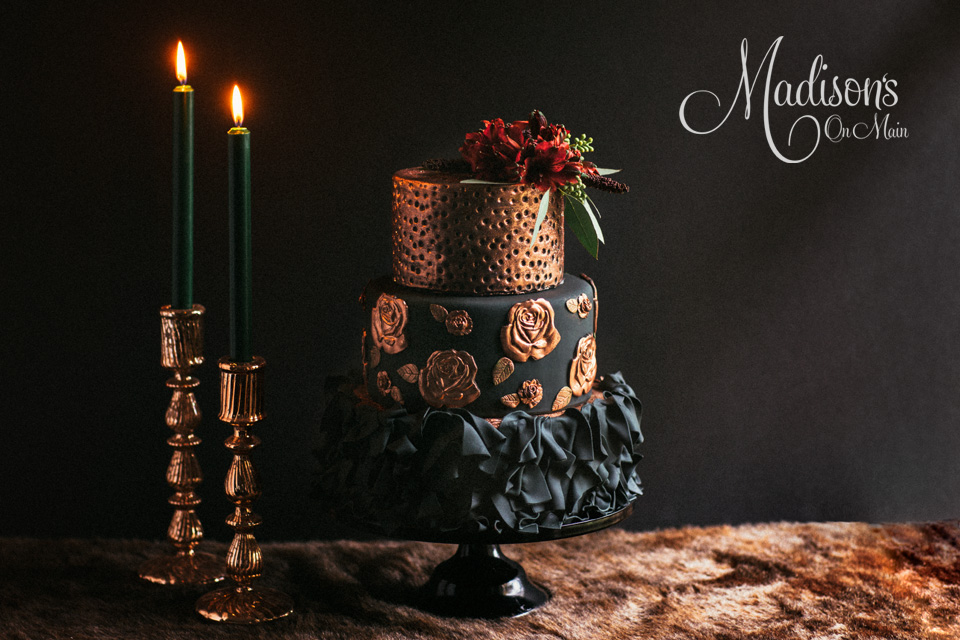 Moody Black and copper fondant wedding cake with ruffles