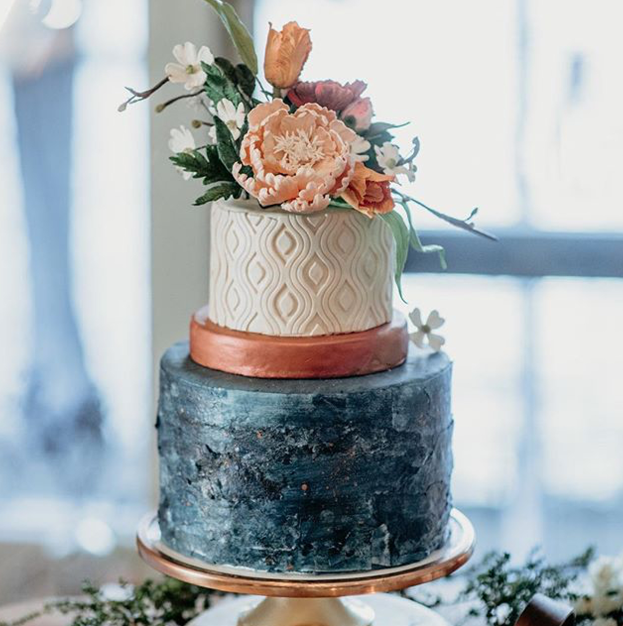 Black and white fondant wedding cake with copper tones