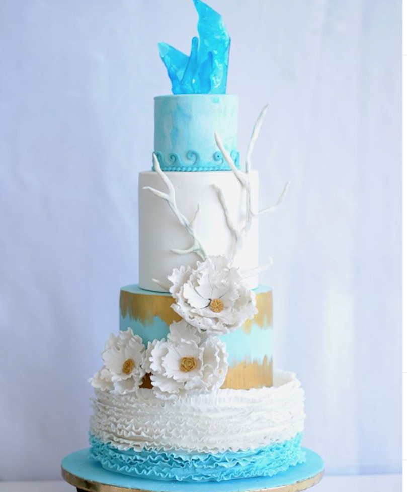 White and blue fondant beach wedding cake