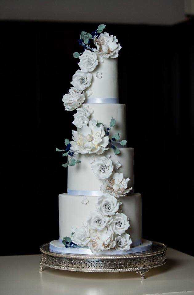 Gray wedding cake with cascading sugar flowers