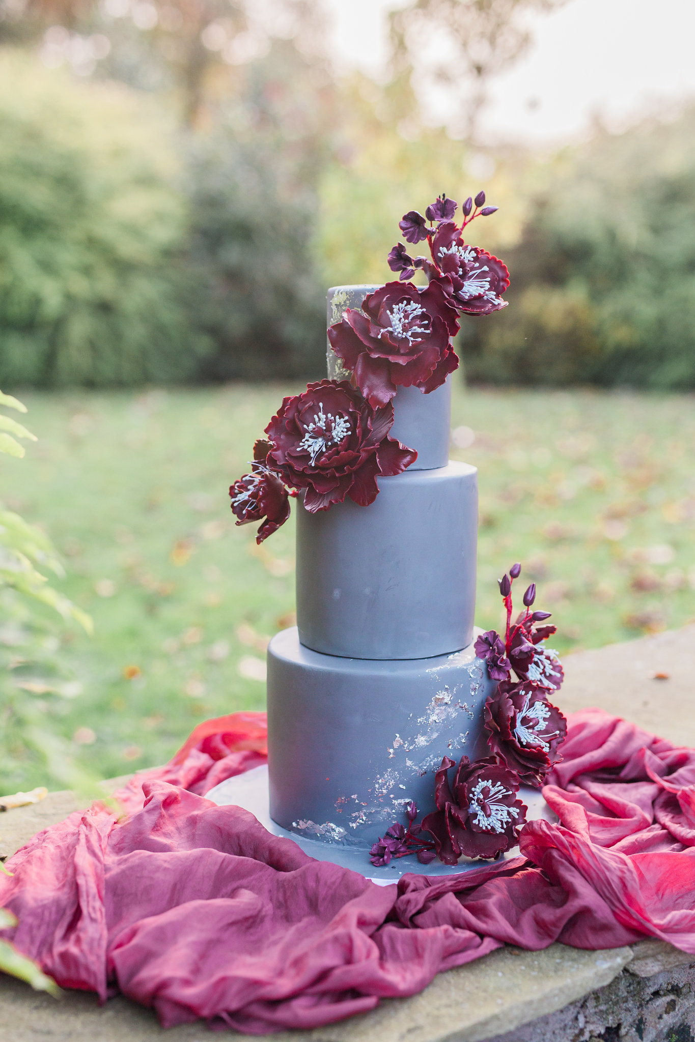Blue Wedding cake with burgundy sugar flowers