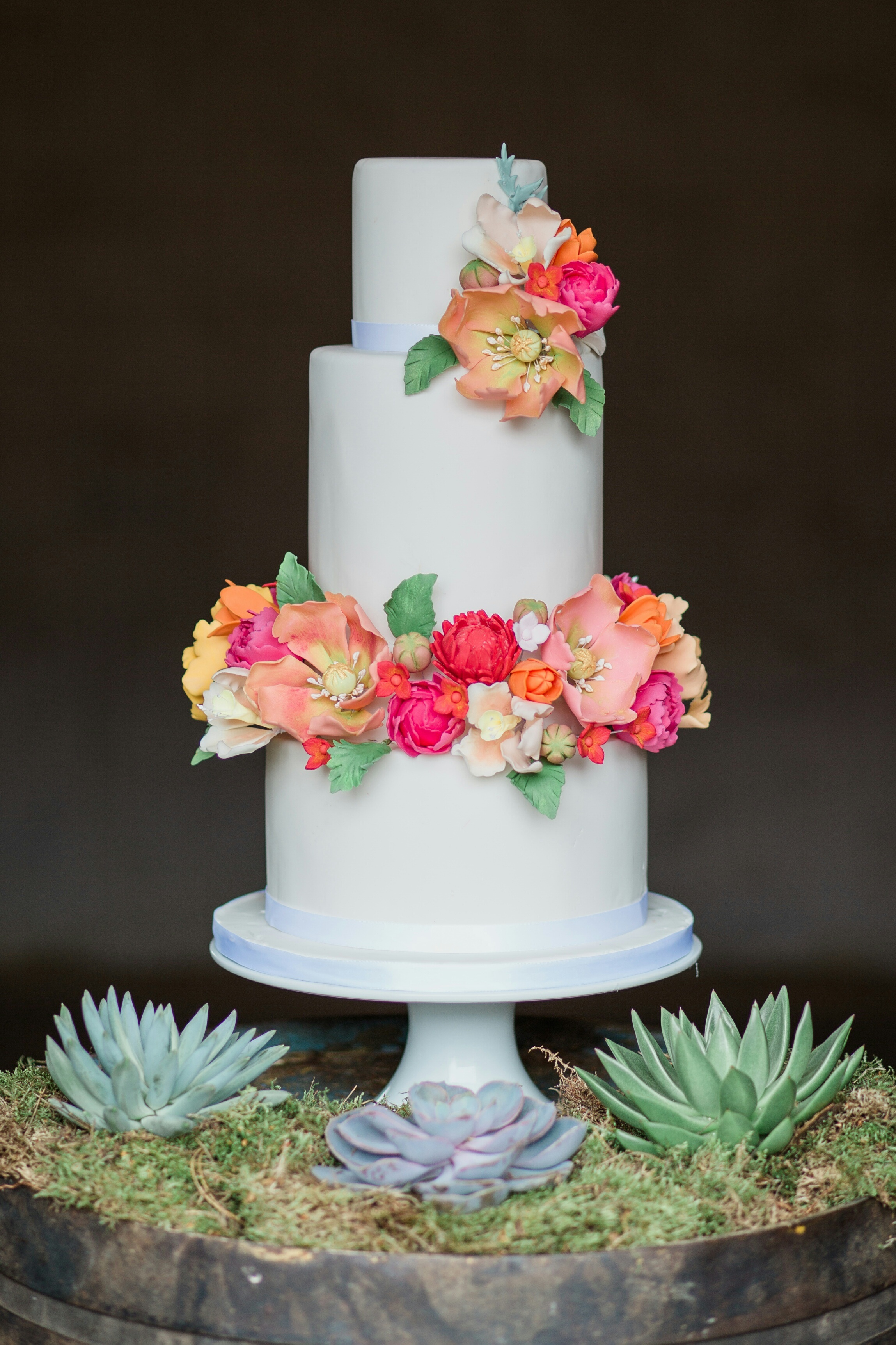 White Wedding cake with bright sugar flowers