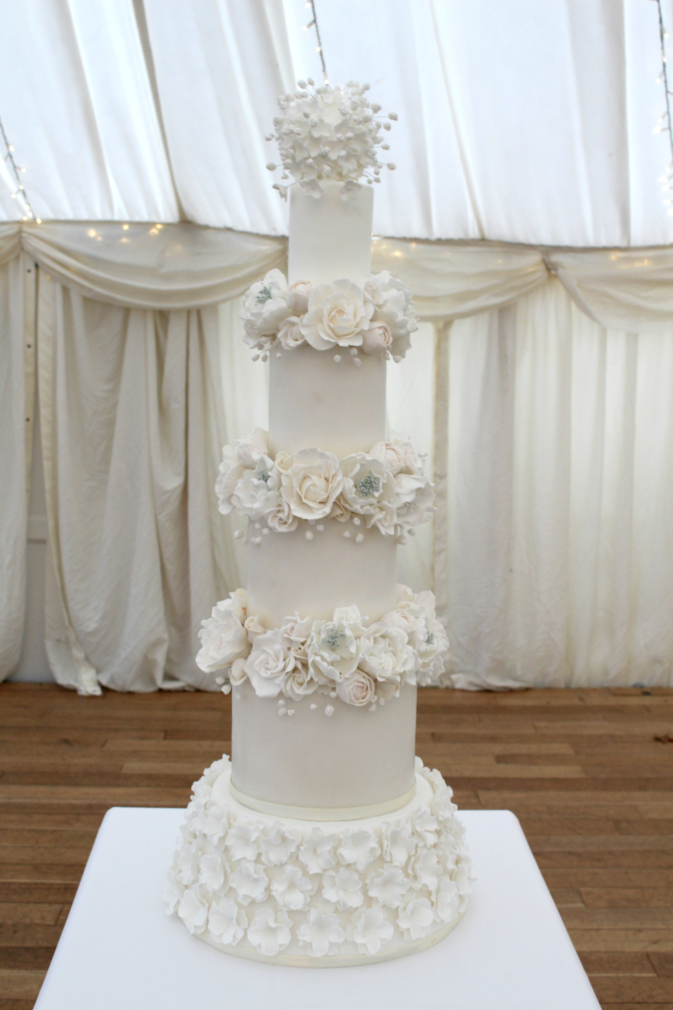 Ivory wedding cake with sugar flowers