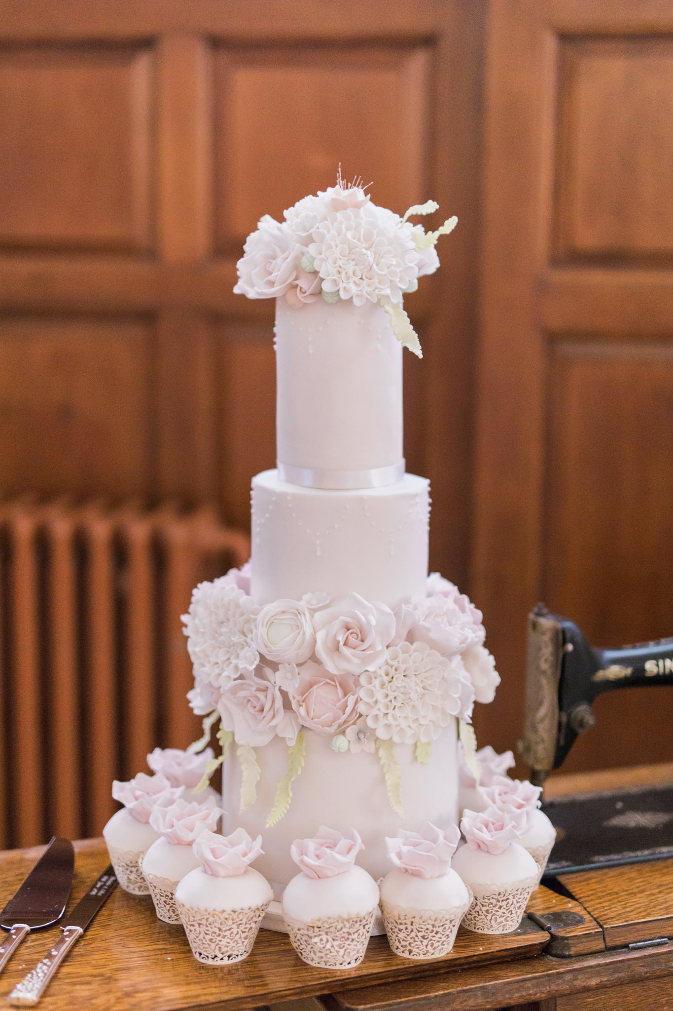 Baby pink wedding cake and cupcakes