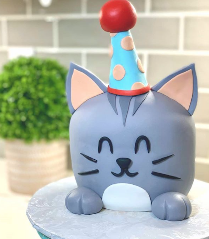 Gray fondant cake in a birthday hat