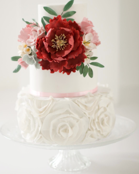 White fondant wedding cake with red gum paste rose