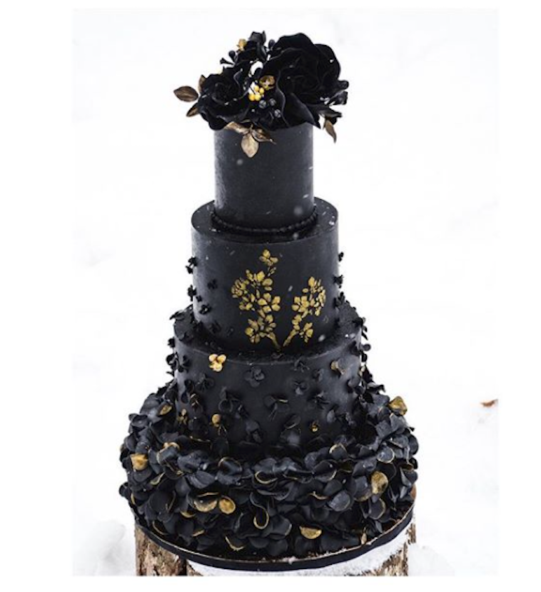 All black ruffled wedding cake with gold accents