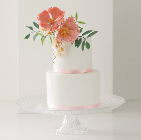 White wedding with peach sugar flowers