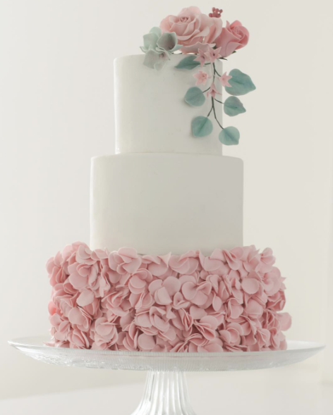 White and baby pink ruffle wedding cake