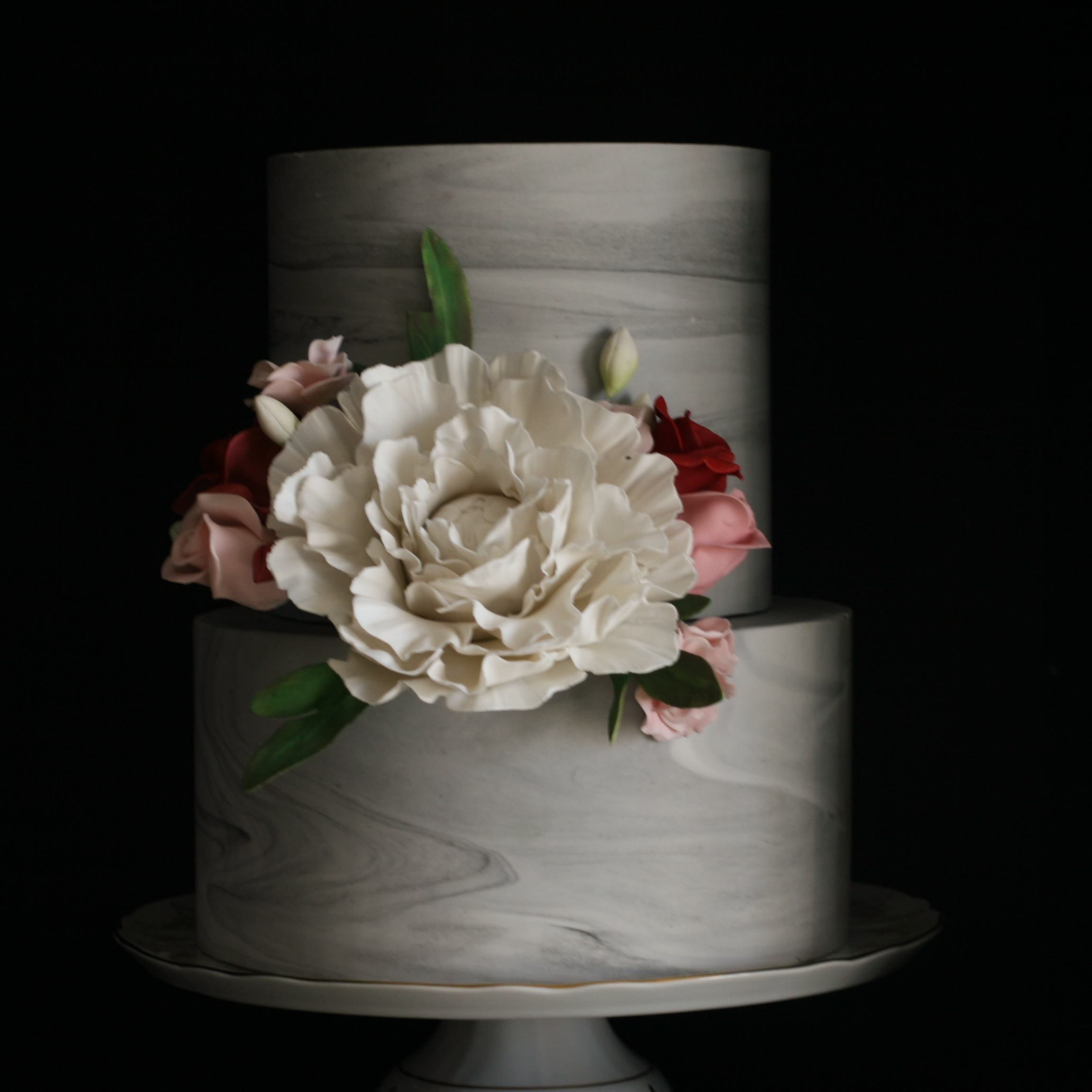 Gray marbled wedding cake with sugar flowers