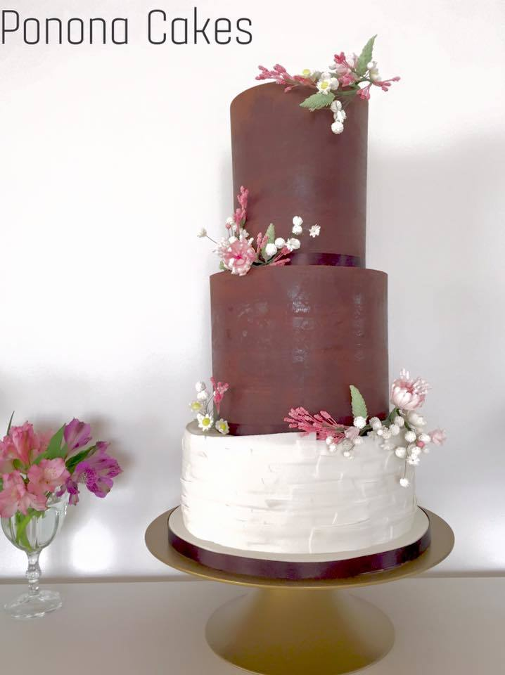 Brown fondant wedding cake with white ruffles
