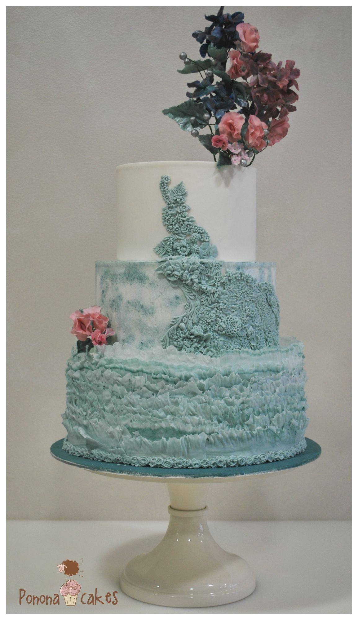 White & turquoise textured fondant wedding cake
