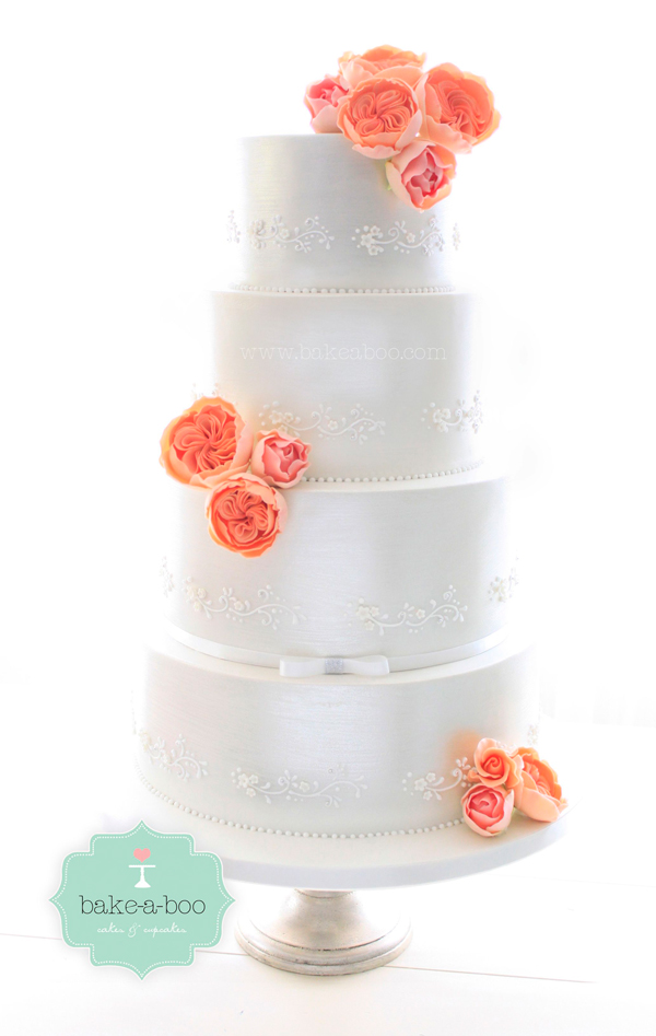 Silver fondant wedding cake with peach sugar flowers