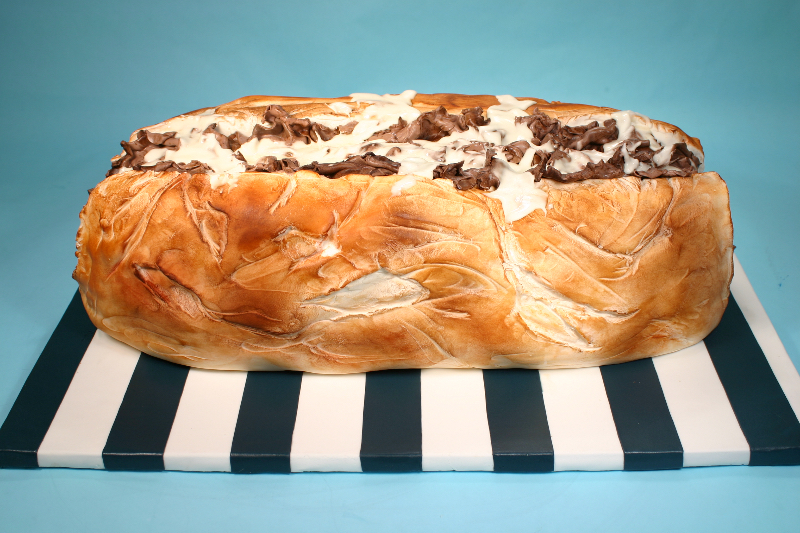 Cheesesteak shaped fondant cake