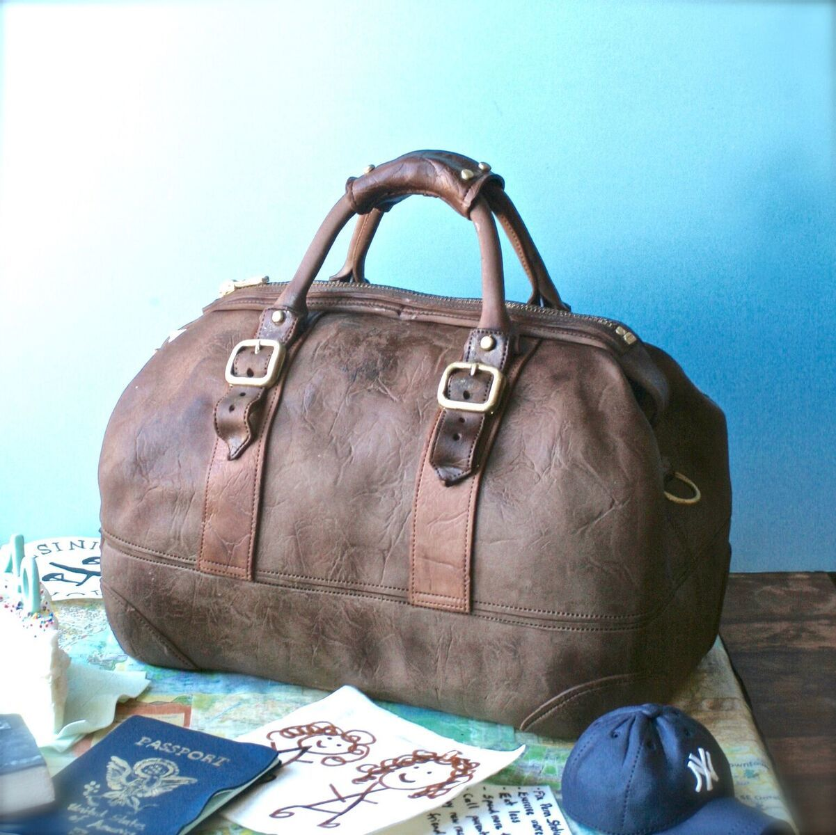Brown travel bag fondant cake
