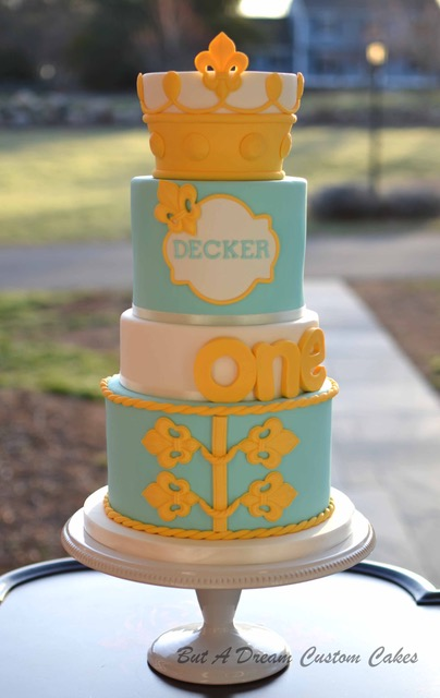 Baby blue and yellow baby boy cake