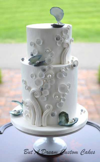 All white ocean themed wedding cake