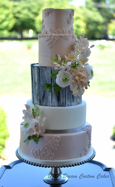 Baby pink and gray birch wedding cake with bas relief