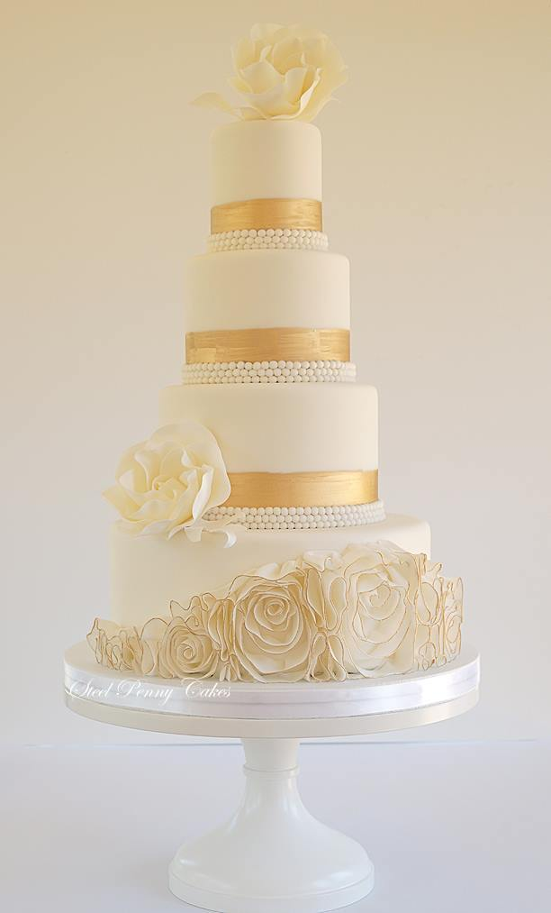 Ivory with gold fondant rosette wedding cake