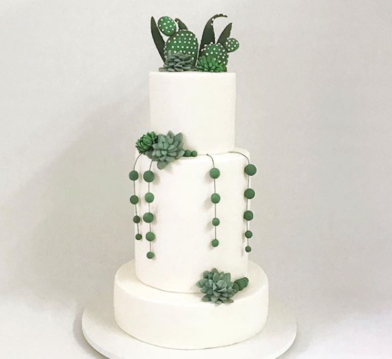 White fondant wedding cake with green gum paste succulents