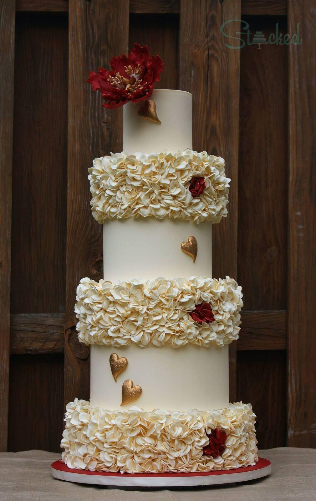 Ivory fondant ruffle wedding cake with hearts