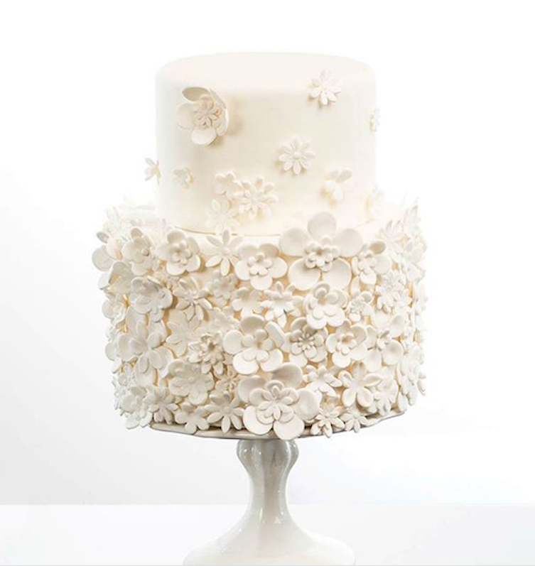 All white fondant wedding cake with delicate flowers