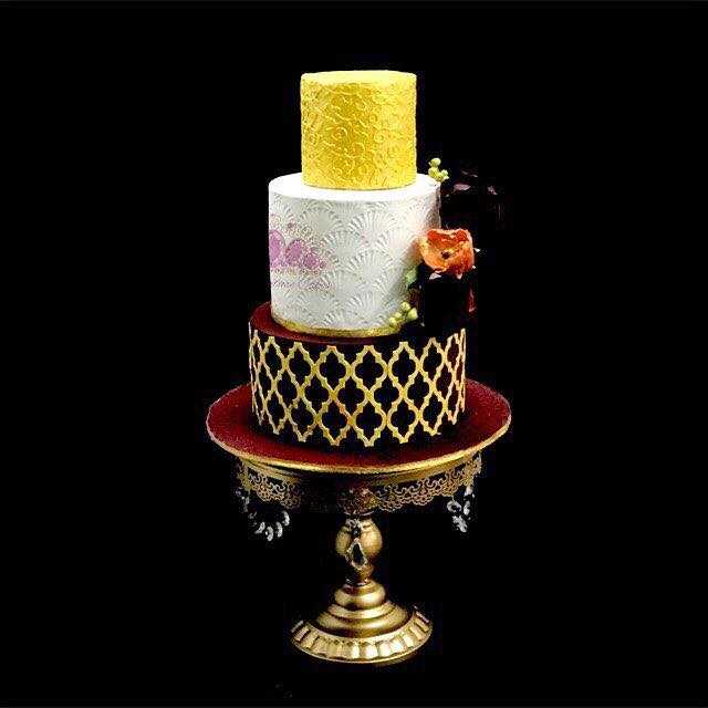 Yellow and black patterned fondant wedding cake