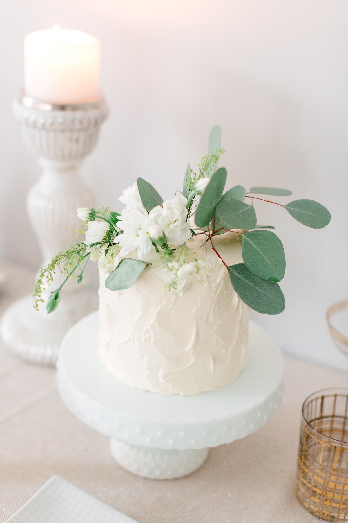 White fondant wedding cake with gum paste greenery