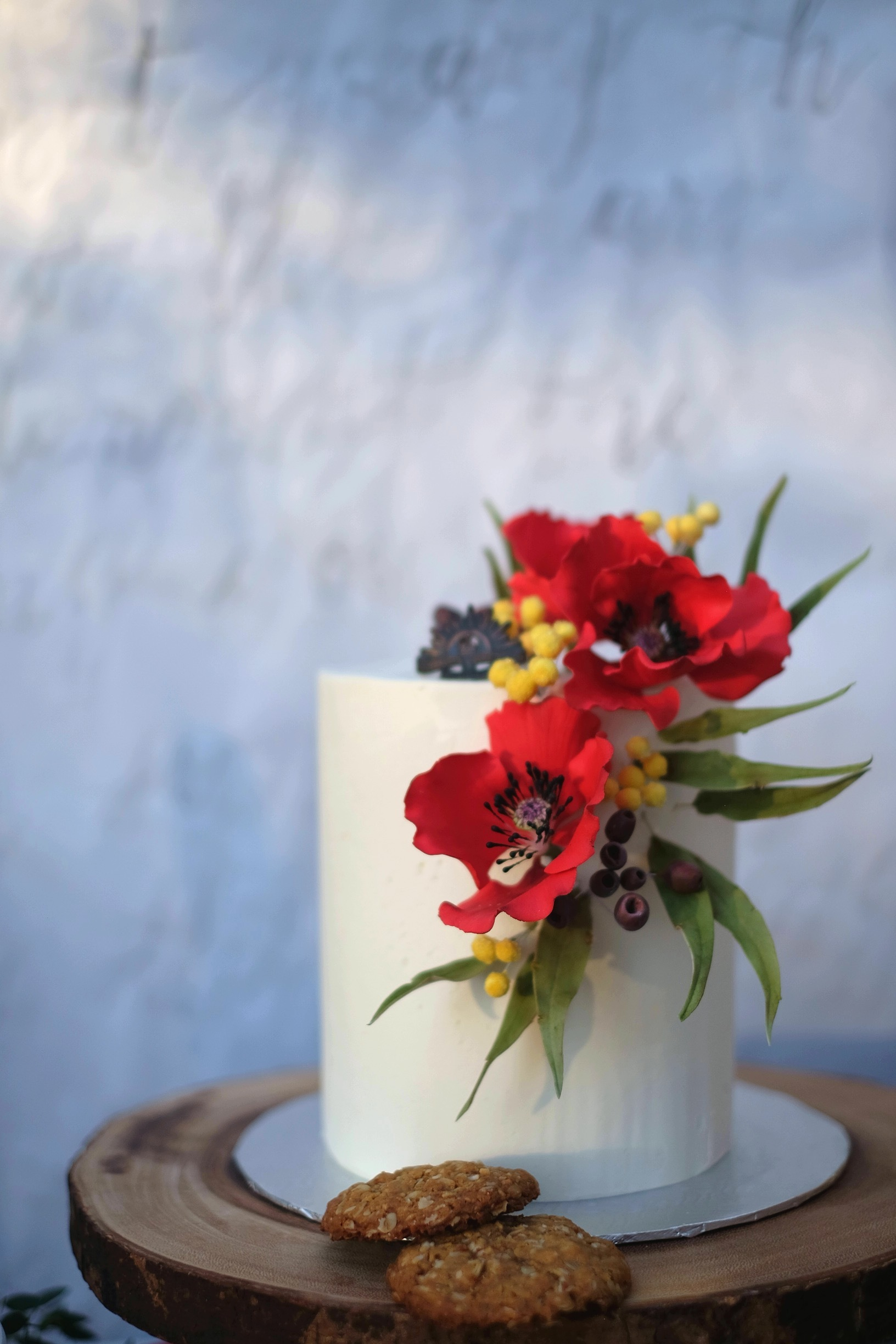 White fondant with red sugar flowers