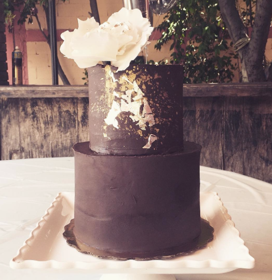 Brown fondant wedding cake with gold