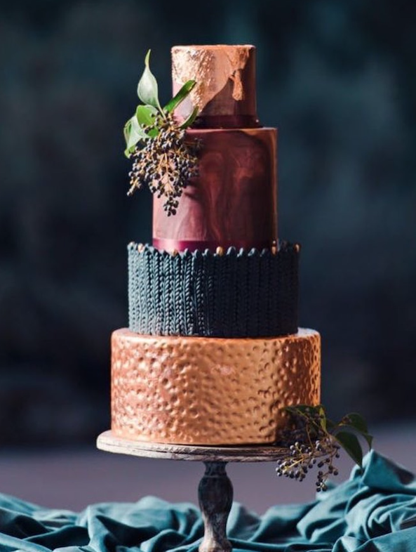 Copper and black fondant wedding cake with burgundy