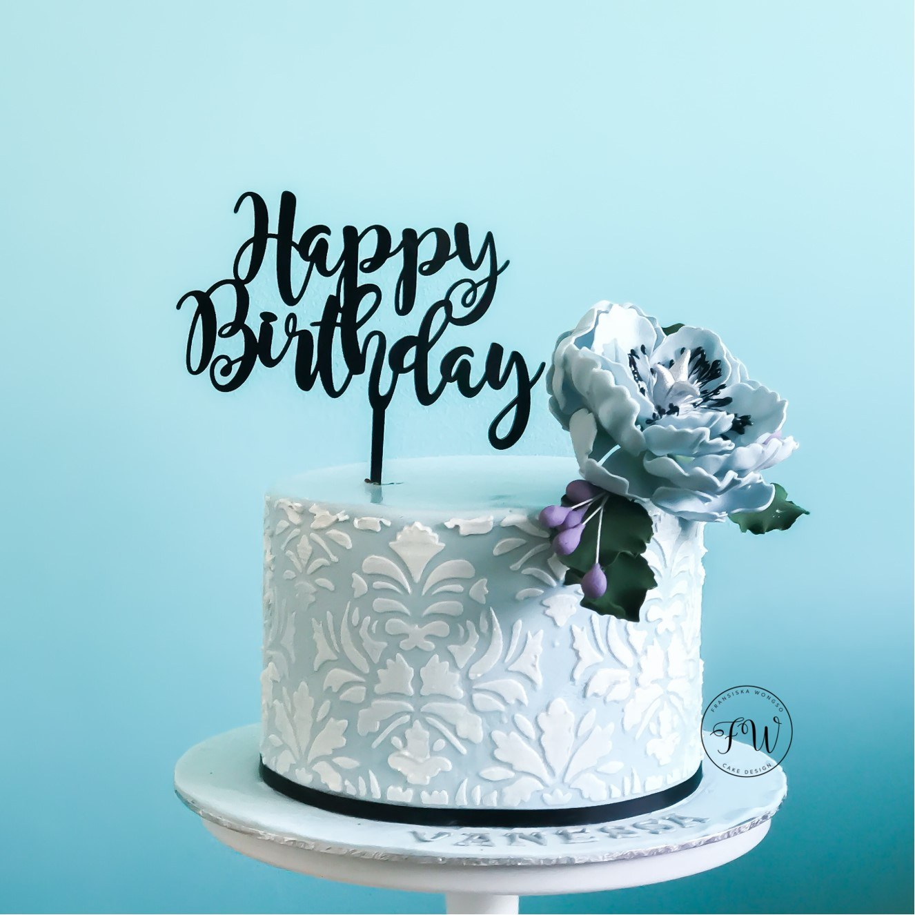Mini light blue and white cake with sugar flower