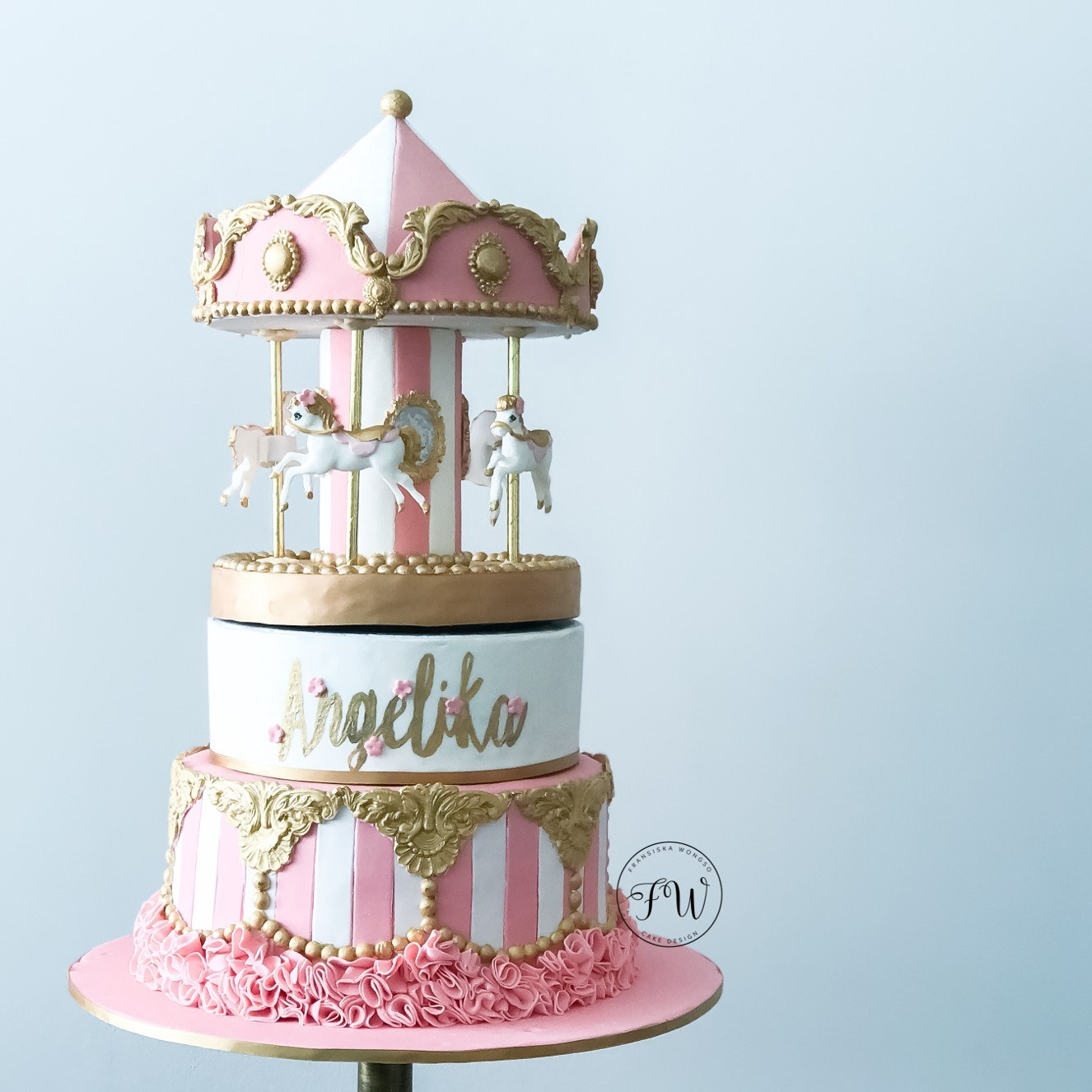 Pink and white baby carousel fondant cake