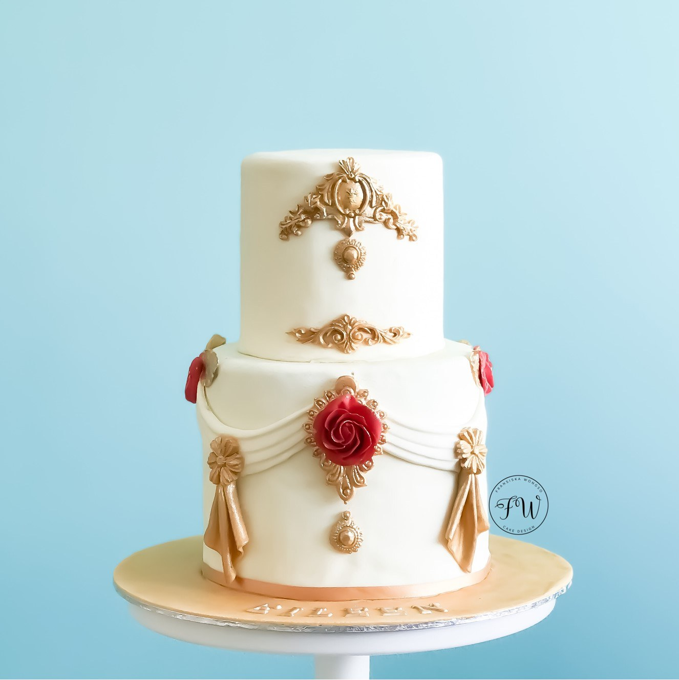 White red and gold baroque style wedding cake