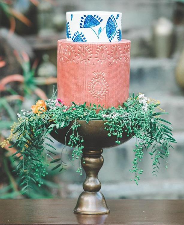 Terra cotta and blue fondant wedding cake
