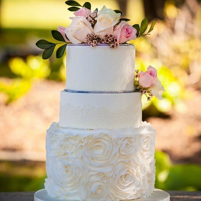 Rustic garden wedding cake with sugar lace, rosettes