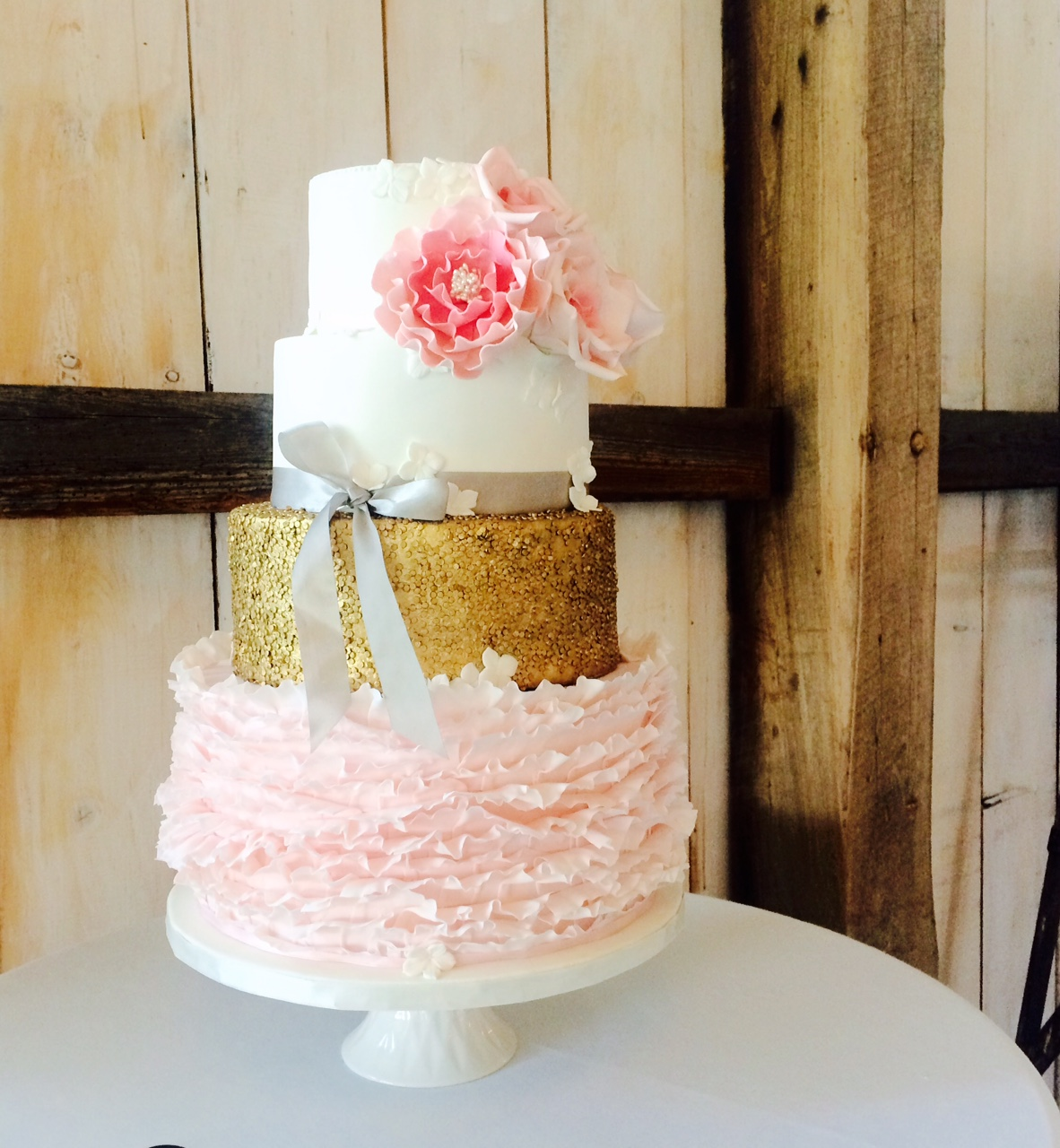 Pink ruffle wedding cake with gold sequins