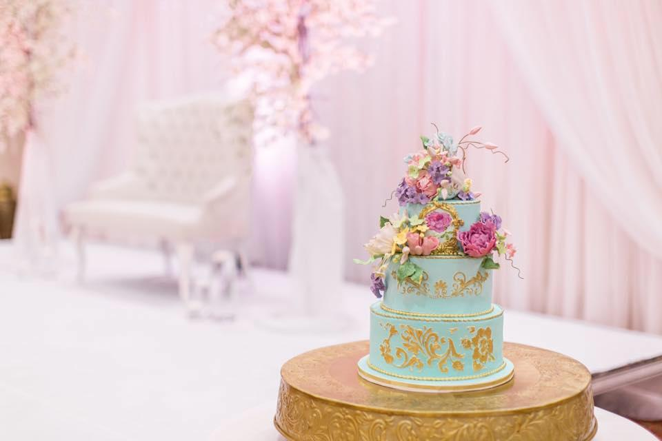 Elegant turquoise wedding cake with pastel sugar flowers