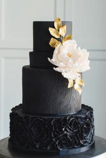 Black wedding cake with white sugar rose