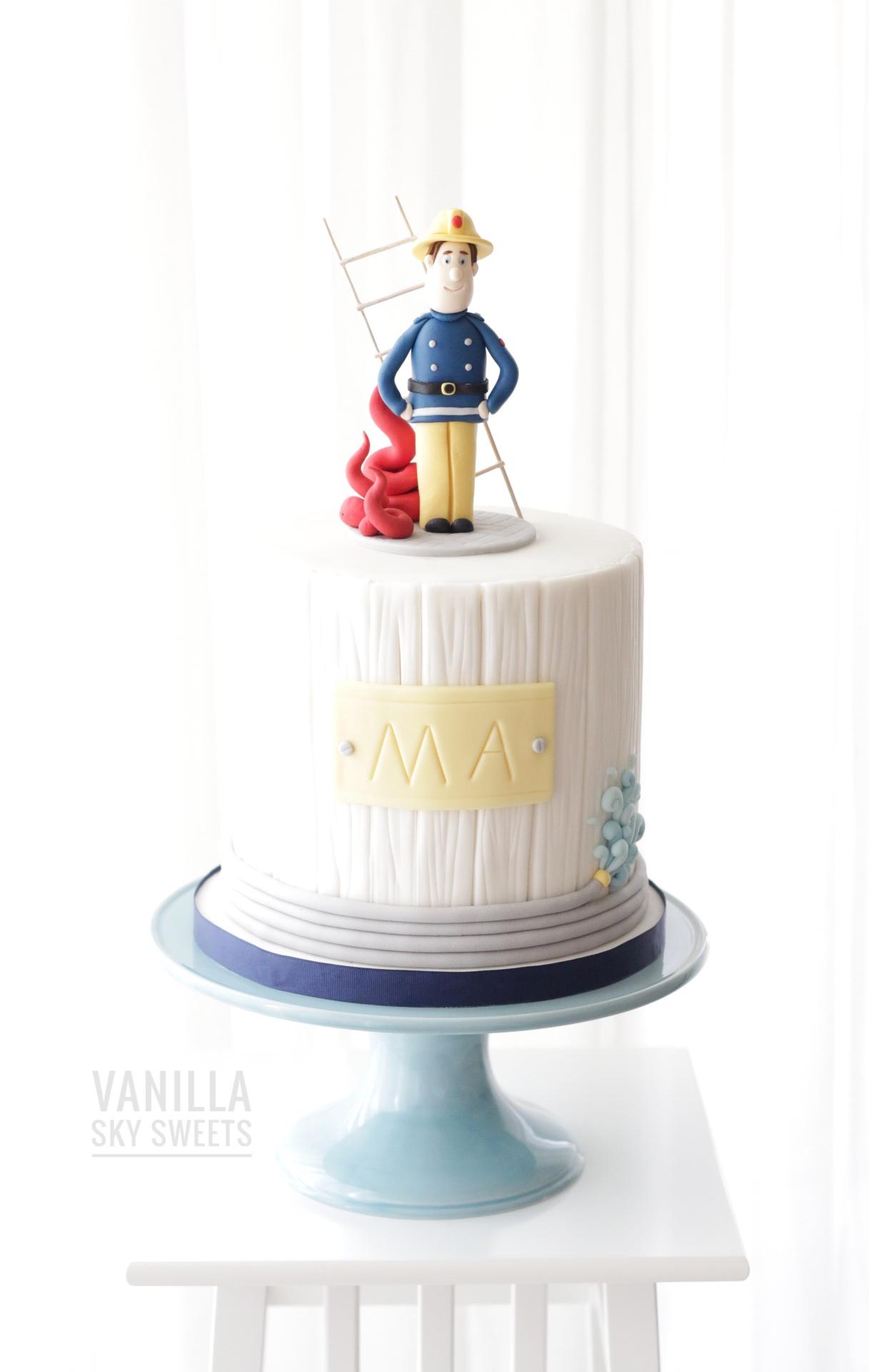 Mini fondant fireman themed birthday cake