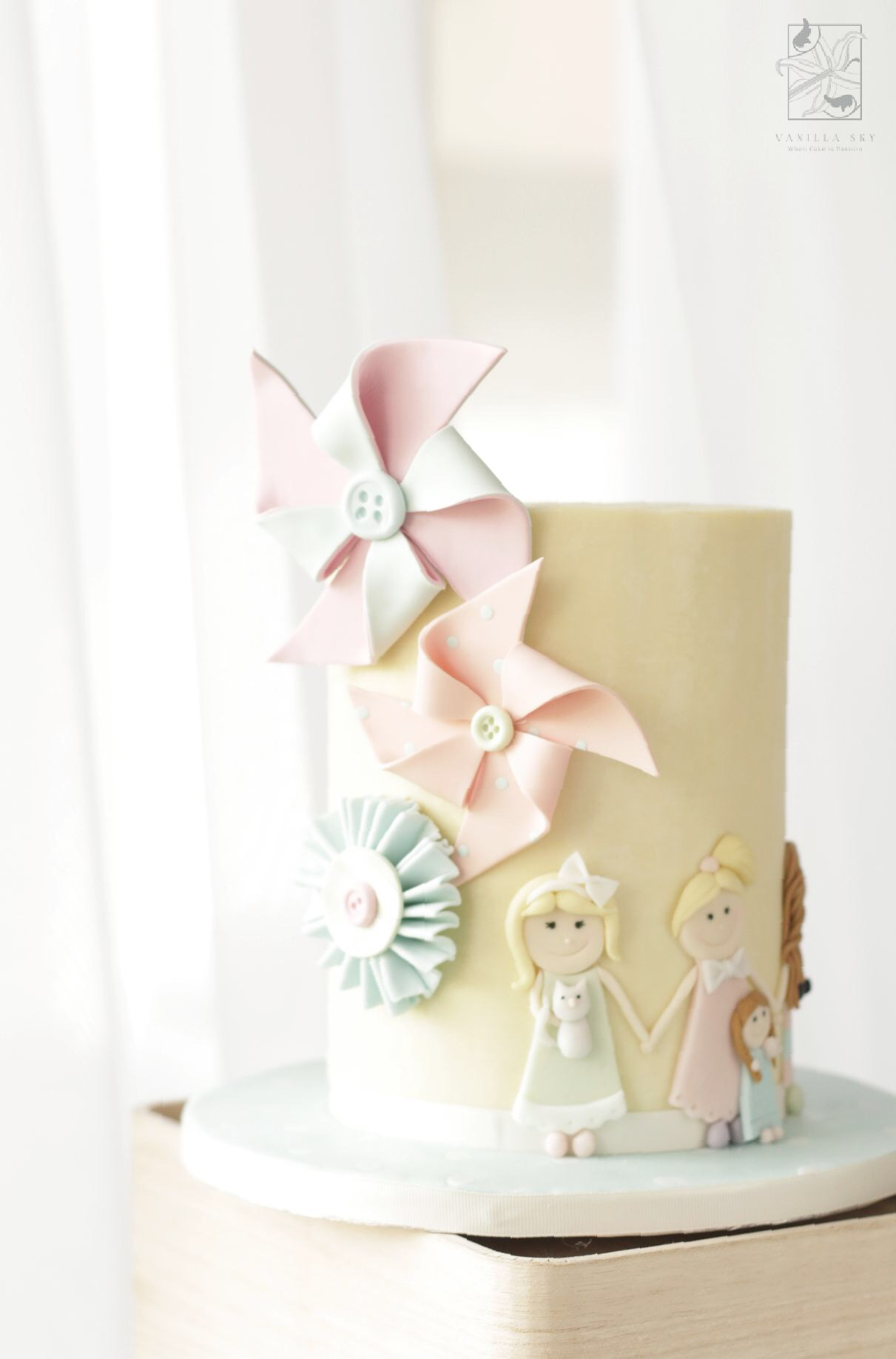 Pastel yellow birthday cake with pinwheels
