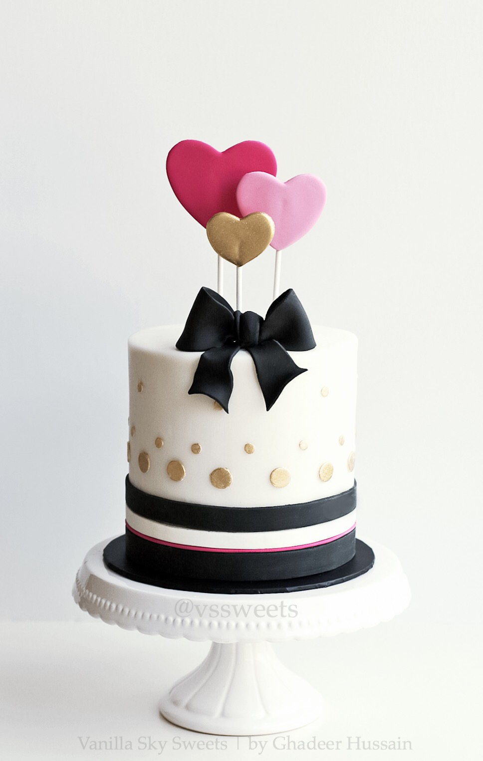 Black and white polka dot heart cake