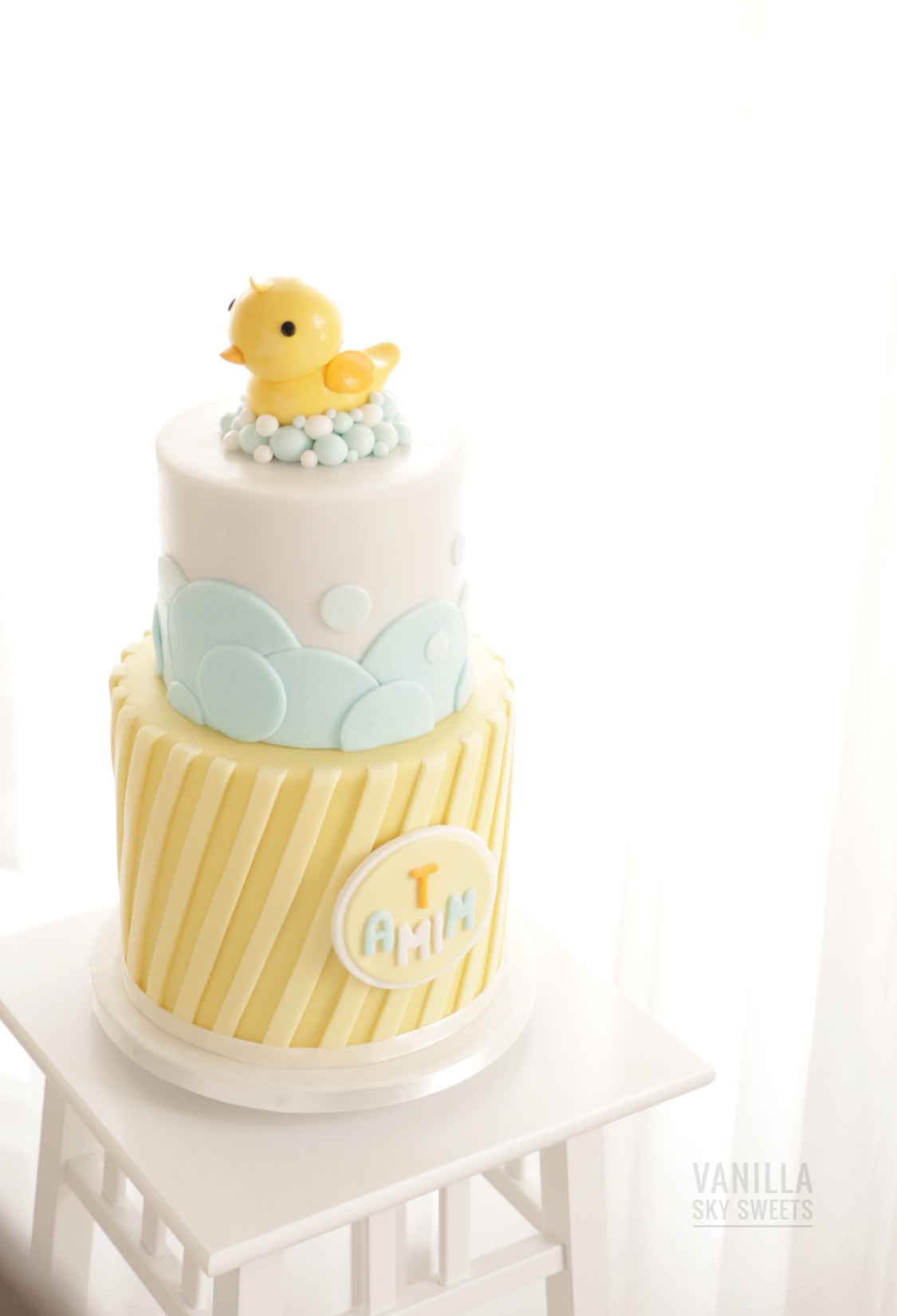 yellow and blue rubber ducky fondant cake