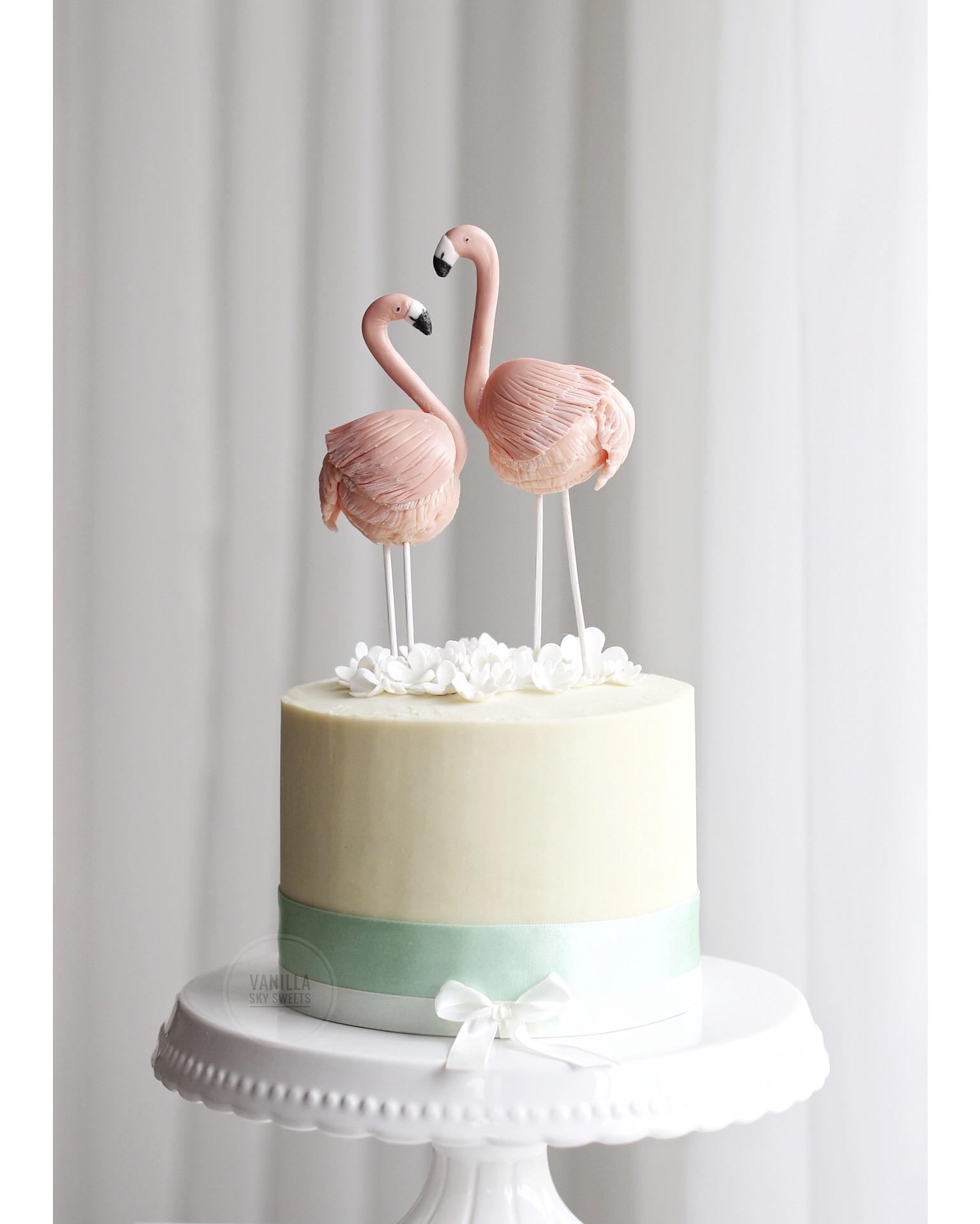 Flamingo topper on a pastel yellow mini cake