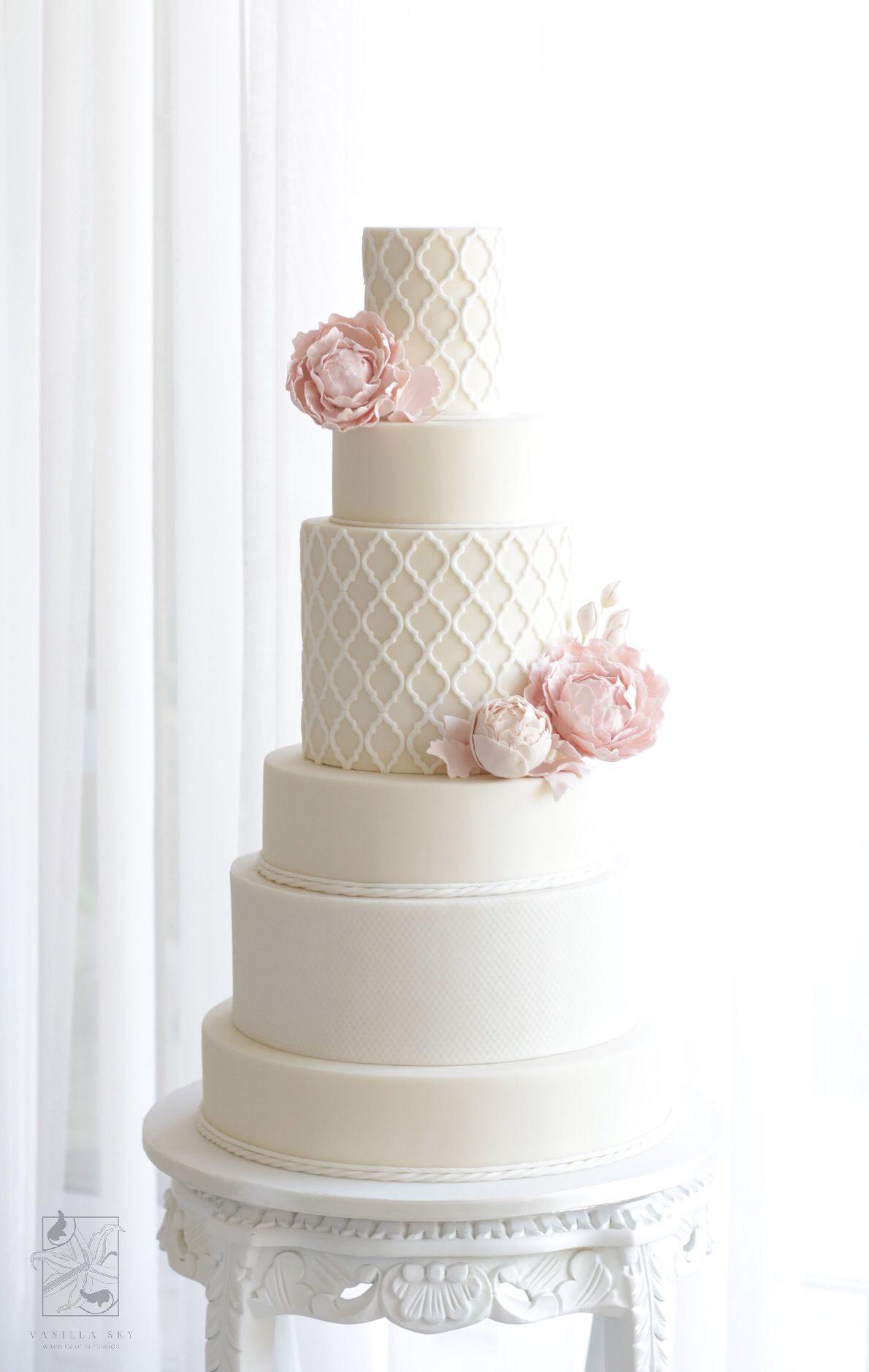 Ivory wedding cake with light pink sugar roses