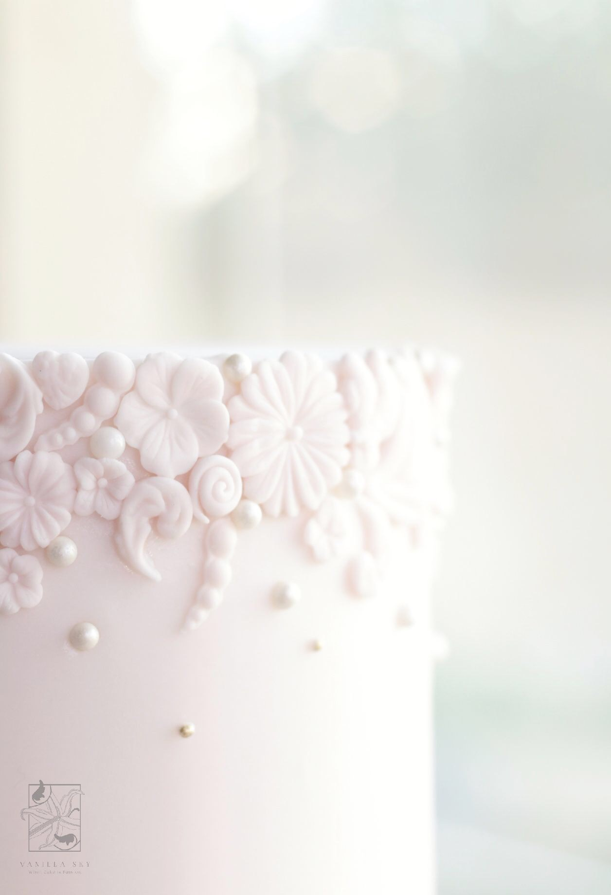 Baby pink bas relief textured wedding cake
