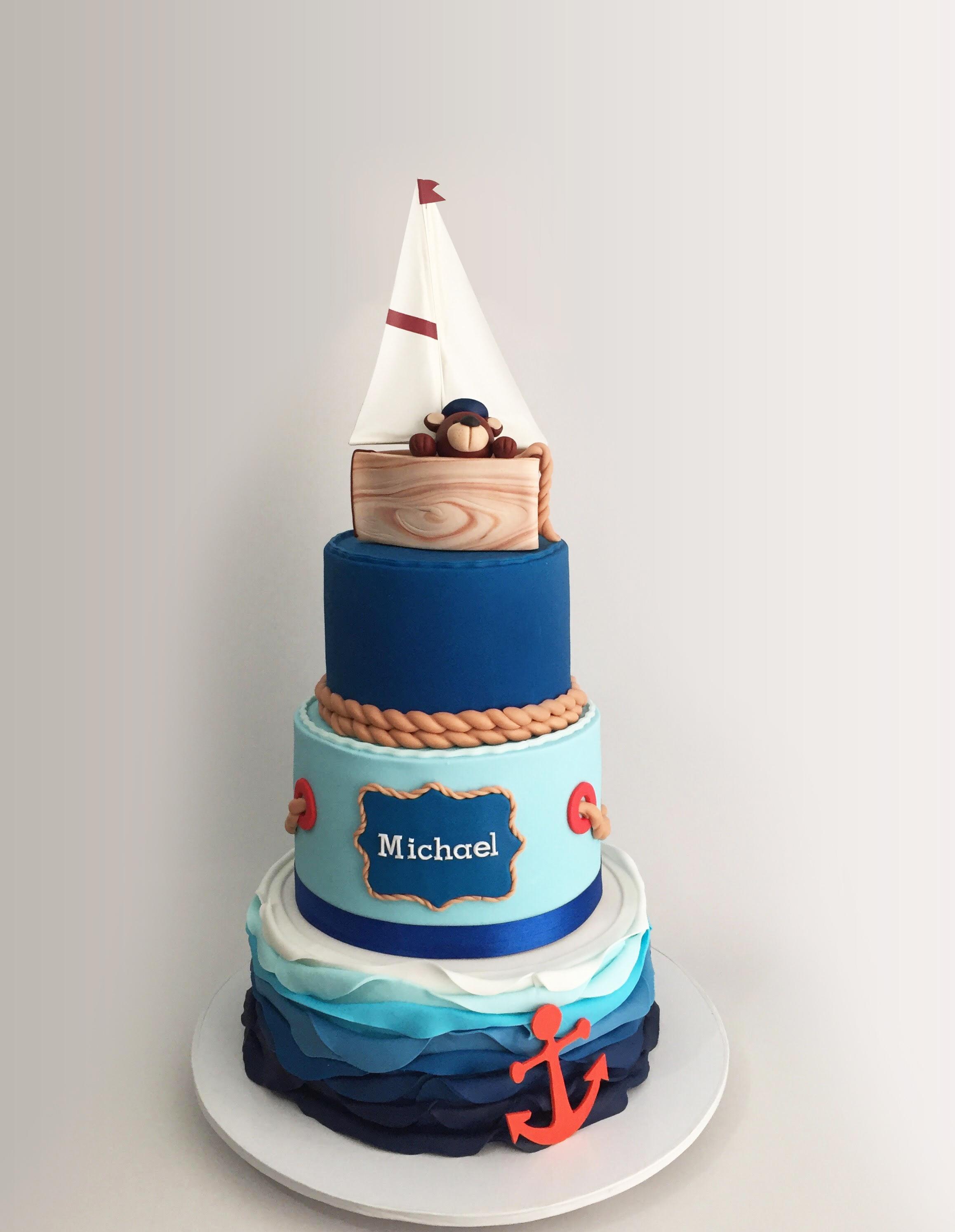 Blue and white fondant sailing birthday cake