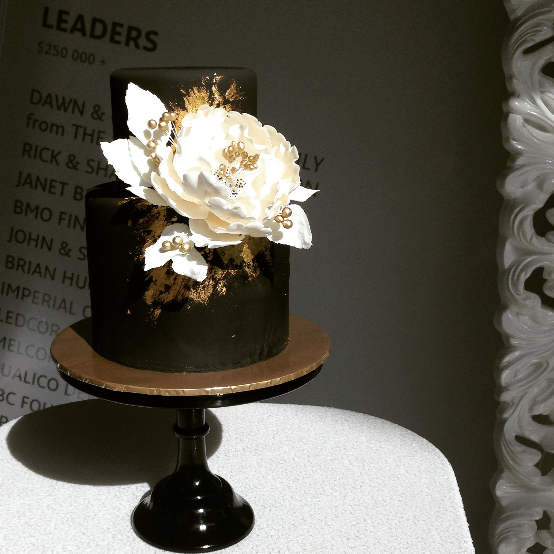 Black wedding cake with white sugar flower